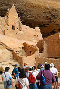 350405-1012 ~ Copyright: George H. H. Huey ~ Visitors at Long House. Second largest Anasazi culture cliff dwelling at Mesa Verde [w/150 rooms and 21 kivas], was occupied from about A.D. 1200-1300, by 150-175 people. Wetherill Mesa. Mesa Verde National Park, Colorado.