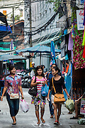 06 JUNE 2013 - BANGKOK, THAILAND:    Women walk through Bobae Market in Bangkok. Bobae Market is a 30 year old market famous for fashion wholesale and is now very popular with exporters from around the world. Bobae Tower is next to the market and  advertises itself as having 1,300 stalls under one roof and claims to be the largest garment wholesale center in Thailand.       PHOTO BY JACK KURTZ