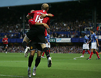 Photo: Lee Earle.<br /> Portsmouth v Manchester United. The FA Barclays Premiership. 15/08/2007.United's Cristiano Ronaldo celebrates with Paul Scholes after he scored their opening goal.