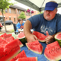 Adam Robison | BUT AT PHOTOS.DJOURNAL.COM<br /> Brad Gillespie, of Our Artworks of Tupelo, cuts fresh watermelon for the LIFE and Our Artworks cookout that was held at Fairpark Tuesday in Tupelo.
