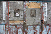 Close up of old wooden door on Kinmen. Kinmen (Jinmen) formely known as Quemoy. The island lies less than 2km off the coast of China, and in 1949 was turned into a front-line of defense for Taiwan by Chiang Kai-shek and the Chinese nationalist Kuomintang (KMT) in the ongoing war with the communist PRC. The island existed under martial law until 1993. Today, Kinmen is a popular tourist destination and home to a lot of traditional Fujian-style architecture.