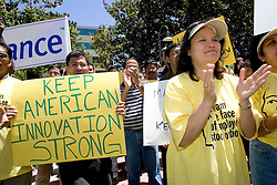 Palo Alto, CALIF. June 24, 2004- Sanjay Noronha, of Elance, L, and Lisa Phan, of  QuickLogic,(R) protest in opposition to stock option regulations outside Palo Alto City Hall, June 24, 2004 Photo by Kim Kulish
