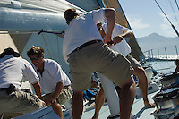 Sailors working on windlass on yacht
