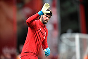 Alisson Becker (1) of Liverpool waves during the warm up ahead of the Premier League match between Bournemouth and Liverpool at the Vitality Stadium, Bournemouth, England on 7 December 2019.