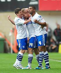 LONDON, ENGLAND - Saturday, October 8, 2011: Tranmere Rovers'  Adam McGurk celebrates with David Buchanan and Joss Labadie after his goal makes it 1-0 during the Football League One match at The Valley. (Pic by Gareth Davies/Propaganda)