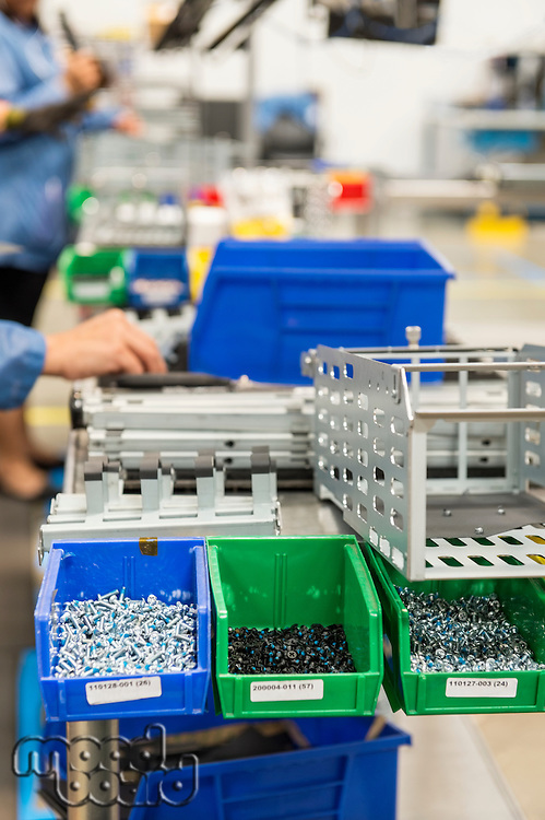 Variety of screws in tray at computer manufacturing industry