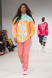 © Licensed to London News Pictures. 30/05/2015. London, UK. A model walks the runway during the Liverpool John Moores University fashion show at Graduate Fashion Week 2015 wearing the collection of graduate student Rachael Plows. Graduate Fashion Week takes place from 30 May to 2 June 2015 at the Old Truman Brewery, Brick Lane. Photo credit : Bettina Strenske/LNP