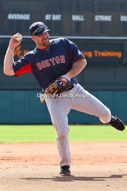 March 16, 2011; Lake Buena Vista, FL, USA; Boston Red Sox third baseman Kevin Youkilis (20) takes infield before a spring training exhibition game against the Atlanta Braves at the Disney Wide World of Sports complex.  Mandatory Credit: Derick E. Hingle