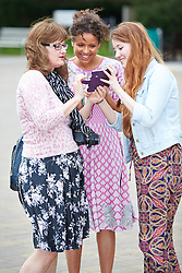 © Licensed to London News Pictures.  14/06/2014. WITNEY, UK. Actress Gugu Mbatha-Raw (centre) greets her former teacher Caroline Organ-Jennings (left) and her daughter Eleonore (right). Mbatha-Raw returned to her home town of Witney in Oxfordshire for a special screening of the film Belle where she plays the lead role. Photo credit: Cliff Hide/LNP
