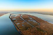 Nederland, Zuid-Holland, Haringvliet, 07-02-2018; overzicht van het eiland Tiengemeten. Het eiland werd oorspronkelijk gebruikt voor de akkerbouw maar is inmiddels 'teruggegeven aan de natuur', de dijken zijn deels doorgestoken, de laatste boer is in 2006 vertrokken. De 'nieuwe natuur' vormt onderdeel van de Ecologische Hoofdstructuur.<br /> The island Tiengemeten in the Haringvliet, was originally used for agriculture but has now &quot;been given back to nature&quot;. Large parts have been flooded and the isle is part of the National Ecological Network. The last farmer left in 2006. Current use, among other, care farm and camping. <br /> luchtfoto (toeslag op standard tarieven);<br /> aerial photo (additional fee required);<br /> copyright foto/photo Siebe Swart