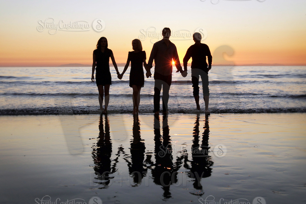 28 December 2011:  Massimo, isabella, Chiara and Luca Sbisa visit Newport Beach for a fun family photo session at sunset.  Silhouette of family at the beach at low tide.