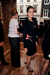 STELLA TENNANT at a party to celebrate the opening of the Louis Vuitton Bond Street Maison, New Bond Street, London on 25th May 2010.