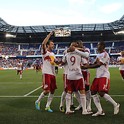 Fabian Espindola, New York Red Bulls, is congratulated by team mates after scoring from the penalty spot during the New York Red Bulls V Real Salt Lake, Major League Soccer regular season match at Red Bull Arena, Harrison, New Jersey. USA. 27th July 2013. Photo Tim Clayton