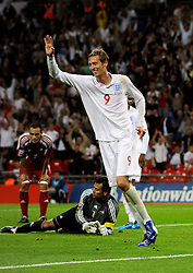 Peter Crouch of England celebrates after scoring to make it 6-0
