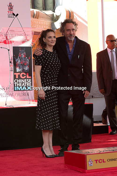 Film directot, producer and writer Tim Burton hugging two time Oscar nominee Winona Ryder during his imprint ceremony in the forecourt of the TLC Chinese Theatre in Hollywood