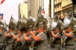 Stock photo of the tuba section of A&M's marching band  participating in one of downtown Houston's parades