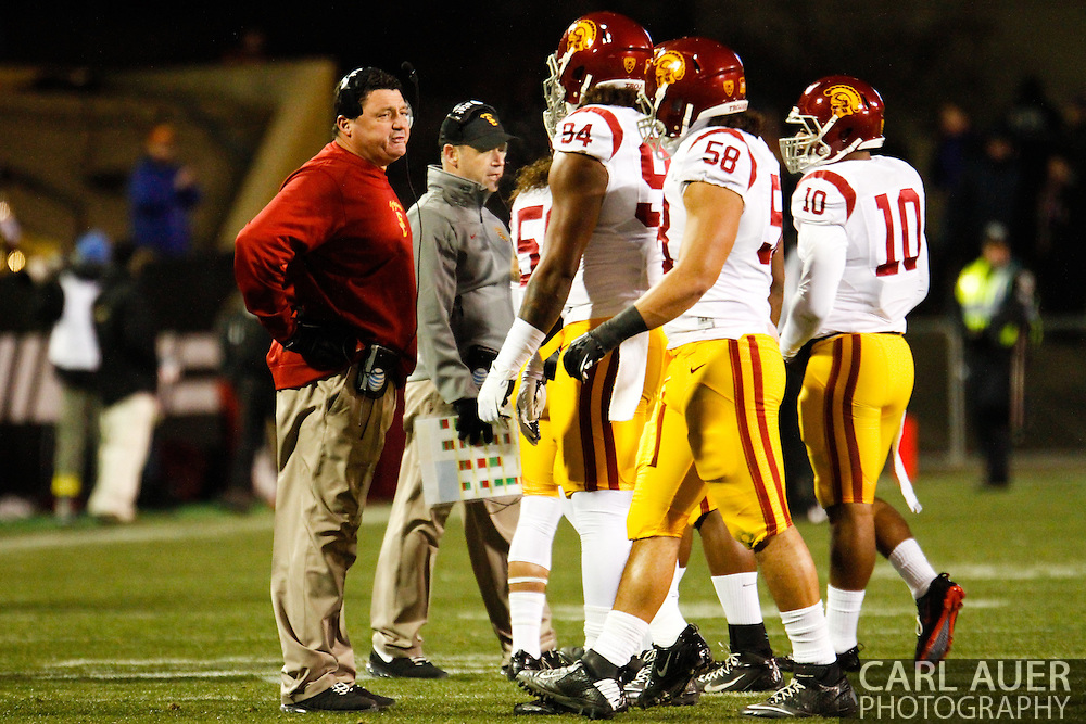 November 23rd, 2013:  USC Trojans interim head coach Ed Orgeron talks to his team during a first quarter injury time out in the NCAA Football game between the University of Southern California Trojans and the University of Colorado Buffaloes at Folsom Field in Boulder, Colorado