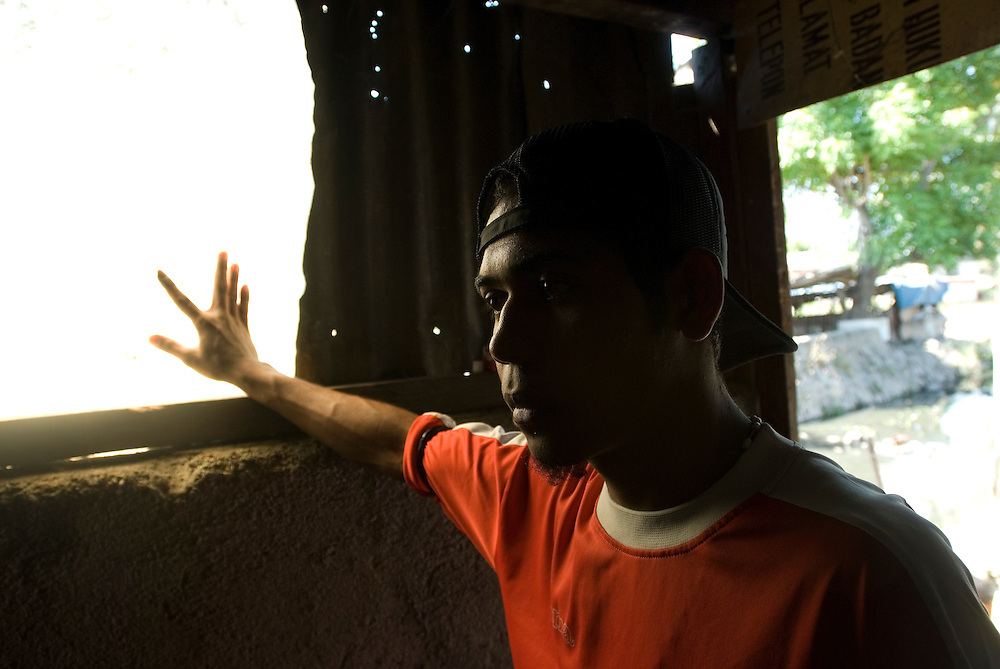 On May 3 2007 an Australian military unmanned surveillance plane crashed into a house in Kampung Alor, Dili. Although a 12 year old member of the Soares family was inside at the time of the incident, no one was injured and damage to the house was minor. Nelson Octavio points out the damage.