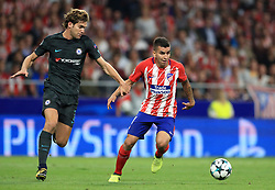 Chelsea's Marcos Alonso (left) and Atletico Madrid's Angel Correa in action