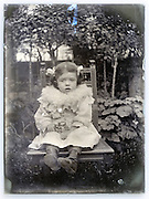 eroding glass plate with little child posing