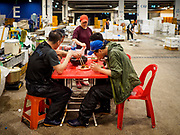 06 JUNE 2018 - SEOUL, SOUTH KOREA: Workers eat dinner in the Noryangjin Fish Market. The Noryangjin Fish Market is the largest fish market in Seoul and has been in operation since 1927. It opened in the current location in 1971 and was renovated in 2015. The market serves both retail and wholesale customers and has become a tourist attraction in recent years.    PHOTO BY JACK KURTZ