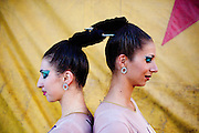 Petya and Viktoriya, who are acrobats from Bulgaria, have a unique act where they hang from their hair and spin. There's no trick to the act, although they both spray their hair wet to make it hurt a little less. Viktoriya is married to one of the show's motorcycle stuntmen, Andrey Medeiros, and the two have a three-year-old son...2009 marks the Cole Bros.'s 125th anniversary and the circus claims to be the oldest American circus under a tent. The 136 x 231 foot tent can house over 2,800 fans, along with several acts where the performers hail from all over the world.
