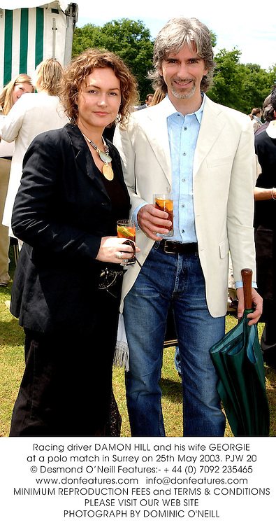 Racing driver DAMON HILL and his wife GEORGIE at a polo match in Surrey on 25th May 2003.PJW 20