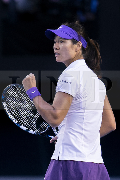 © Licensed to London News Pictures. 26/01/2013. Melbourne Park, Australia. Li Na reacts with a fist pump after winning a point during the Womens Final between Victoria Azarenka and Li Na of the Australian Open. Photo credit : Asanka Brendon Ratnayake/LNP