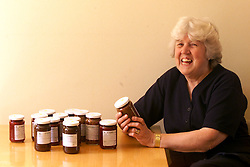 Marion Chilcott was  at the WI Triennial general meeting at Wembley. Marion protested that Tony Blair was becoming too political in his speech. Marion at her home in Baldock. She makes chutney to sell at the WI markets , June 8, 2000. Photo by Andrew Parsons / i-images..