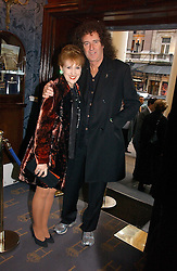 Musician BRIAN MAY and actress ANITA DOBSON at a gala evening preview of Noel Coward's play Hay Fever in aid of Masterclass at The Theatre Royal, Haymarket, London on 26th April 2006.<br /><br />NON EXCLUSIVE - WORLD RIGHTS