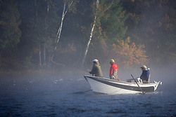 Fly-fishing from a driftboat near Moosehead Lake Maine USA