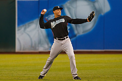 June 28, 2011; Oakland, CA, USA; Florida Marlins right fielder Mike Stanton (27) warms up in the outfield before the game against the Oakland Athletics at the O.co Coliseum.  Oakland defeated Florida 1-0.