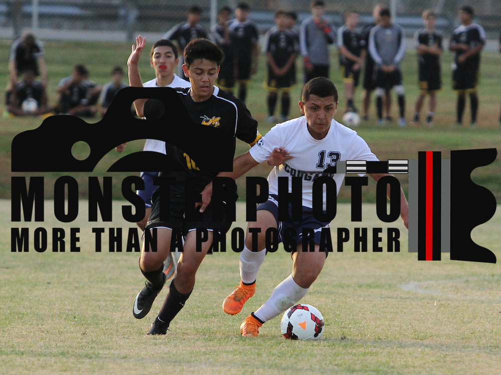 Delcastle Midfield Michael Delgado (13) dribbles the ball up the field as Newark Forward Diego Guzman (10) defends in the second half of regular season soccer match between Newark and Delcastle Thursday, Oct. 22, 2015 at Delcastle in Wilmington.