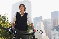 Man standig at bicycle