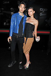 LEAH WELLER and TOMO KURATA at a party to launch the Gucci designed Fiat 500 customized by Gucci Creative Director Frida Giannini in collaboration with FIAT's Centro Stile, held at Fiat, 105 Wigmore Street, London on 27th June 2011.