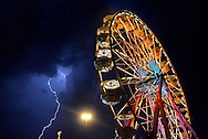 Lightning arches across the sky behind the ferris wheel at the York Fair, Wednesday September 13, 2011. Severe lightning and rain delayed the Toby Keith concert and emptied the Midway..John A. Pavoncello photo
