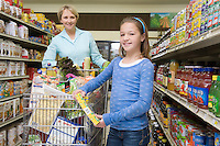 Single mother shopping with daughter