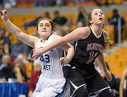 Bluefield center Jia Coppola (11) boxes out Wyoming East forward Alexandria Lusk (43) during a first round game at the Charleston Civic Center.