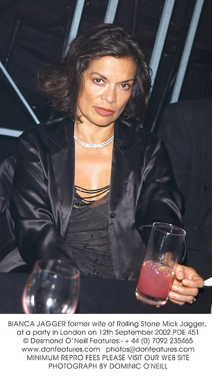 BIANCA JAGGERformer wife of Rolling Stone Mick Jagger, at a party in London on 12th September 2002.PDE 451
