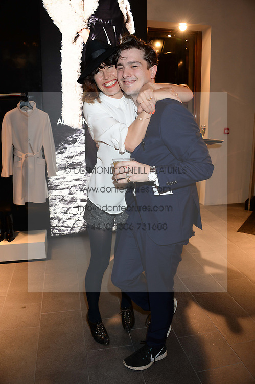 TABITHA DENHOLM and JACKSON BOXER at the opening of the Tiger of Sweden Store, 210 Piccadilly, London on 3rd October 2013.