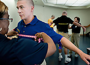 "A freshman is measured for Naval uniforms during his processing on his first day at the U.S. Naval Academy in Annapolis, MD. Approximately 1,230 young men and women arrived at the U.S. Naval Academy's Alumni Hall, Thursday, July 1, for Induction Day to begin their new lives as ""plebes"" or midshipmen fourth class (freshmen). ""I-Day"" culminates when the members of the Class of 2014 take the oath of office at a ceremony at 6 p.m. in Tecumseh Court, the historic courtyard of the Bancroft Hall dormitory. Over 17,400 young men and women applied to be members of the Naval Academy Class of 2014 - a record for USNA."