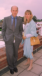 MR & MRS PEREGRINE ARMSTRONG-JONES he is the half brother of the Earl of Snowdon, at a race meeting in Sussex on 31st July 1998.MJH 41