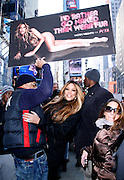 Wendy Williams and Kevin Hunter pose to unveil PETA Campaign poster in Times Square in New York City, New York on November 28, 2012.