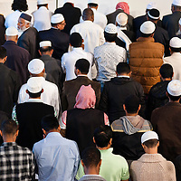 London, UK - 20 July 2012: London's Muslim community celebrates the first day of Ramadan in the East London Mosque, the largest in Britain.