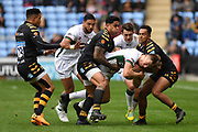 London Irish wing Ollie Hassell-Collins (11) is tackled by Wasps wing Zach Kibirige(14) and Wasps hooker Gabriel Oghre  (16)  and during the Gallagher Premiership Rugby match between Wasps and London Irish at the Ricoh Arena, Coventry, England on 20 October 2019.