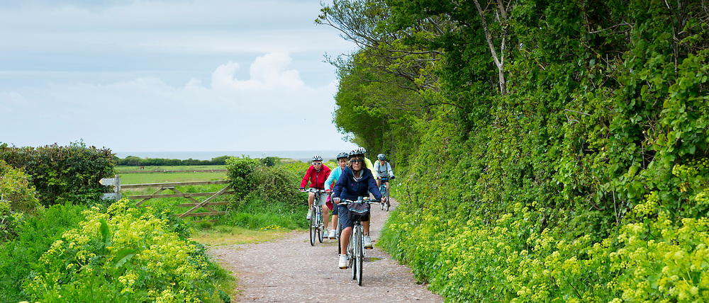 Cyclists by Bossington Beach in Exmoor, Somerset, United Kingdom