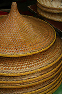 Cantonese Conical Hats - The conical Asian hat, sedge hat, rice hat, paddy hat is a simple conical hat originating in East, South Asia and Southeast Asia, particularly China, Cambodia, Indonesia, Japan, Korea, Philippines, India andVietnam. It is kept on the head by a cloth chin strap; The hat is useful as protection from the sun and rain.