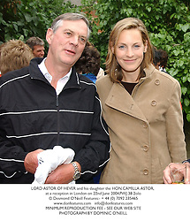 LORD ASTOR OF HEVER and his daughter the HON.CAMILLA ASTOR, at a reception in London on 22nd June 2004.PWJ 38 2olo
