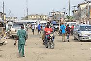 Okada driver with passenger, Lekki district, Lagos, Nigeria, West Africa.