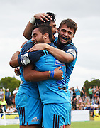 Sam Nock and Matt McGahan congratulate Melani Nanai during a pre season Super Rugby match. Blues v Storm, Pakuranga Rugby Club, Auckland, New Zealand. Thursday 4 February 2016. Copyright Photo: Andrew Cornaga / www.Photosport.nz